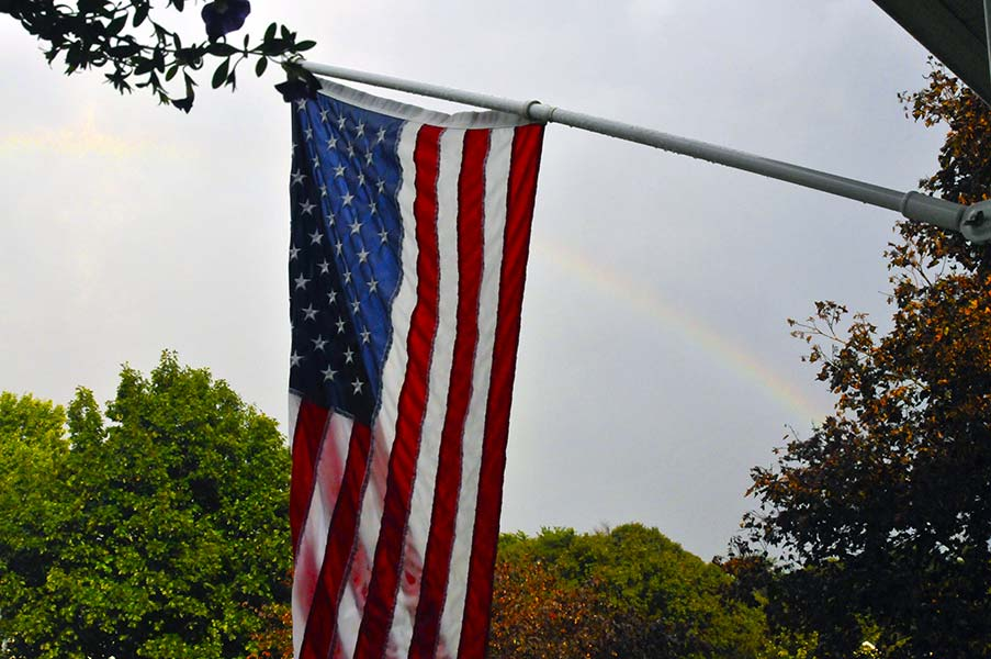 Country Place community American flag and rainbow